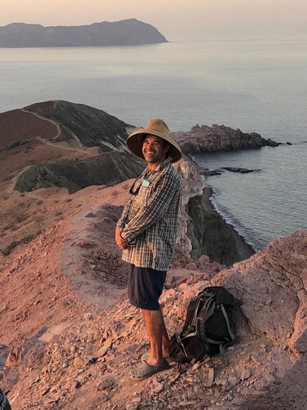 Gage Dayton posing along the coast.