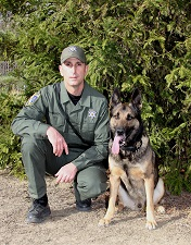 Warden Paul Cardoza and K-9 Kilo