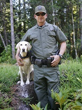 Warden Patrick Freeling and K-9 Cali