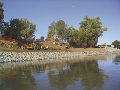 construction along a river bank