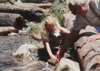 Julia releasing her trout with the help of a volunteer in 1999