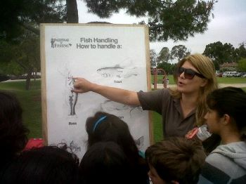 Hillary giving a presentation on fish handling at a Fishing in the City event.