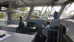 Interior pilot's seat on a 32-foot boat vessel