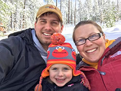 Scientist, Brian Olson, his wife and daughter in the snow