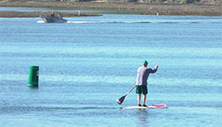 person on a paddleboard on Newport Bay, Pacific Ocean