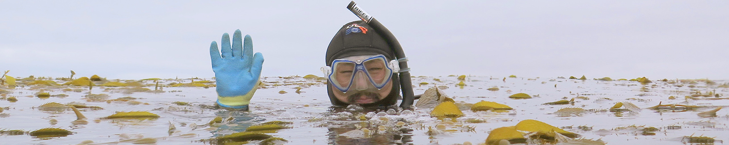 man in snorkel gear waving