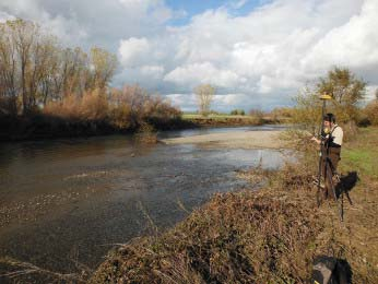iologist conducting RTK survey on Butte Creek