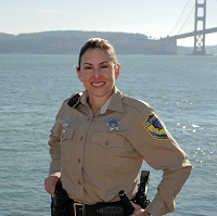 warden in front of San Francisco Bay