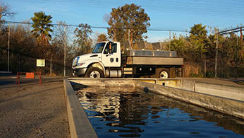 Fillmore Trout Hatchery - truck parked next to pond