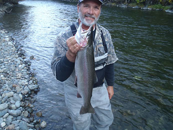 Person holding Steelhead Trout