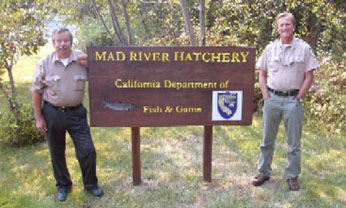 Mad River Hatchery personnel and sign