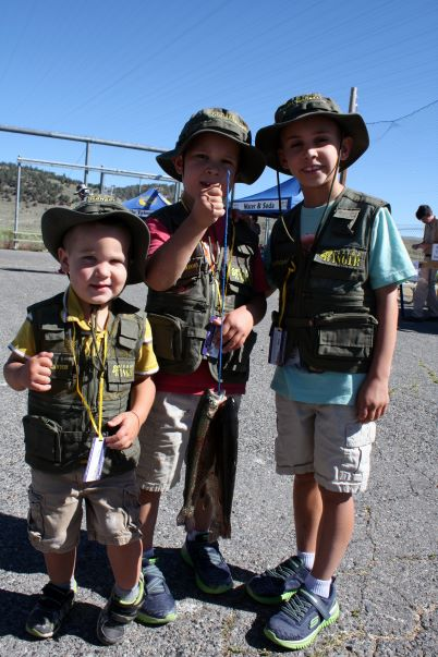 Children holding trout at Hot Creek Hatchery