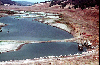 (Figure 2. Uvas Reservoir in the summer of 1977. Photo courtesy of Dr. Jerry Smith, San Jose State University.)