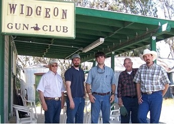 five men by Widgeon Gun Club building