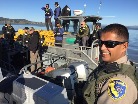 OSPR Wildlife Officer oversees boom deployment.