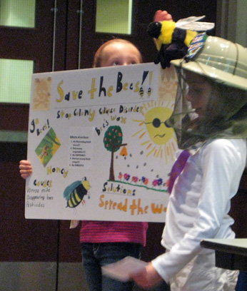 girls presenting on bees