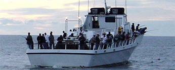 Anglers aboard a commercial passenger fishing vessel. CDFW photo by E. W. Roberts III