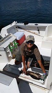 Ali Kearney samples a lingcod in Santa Cruz Harbor. Photo credit: J. Schaaf-DaSilva